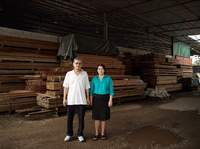 Third Brother with Wife by the sawmill where they work, Kuala Lumpur