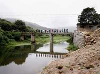 The bridge built by Father, his Brother, and Father's First Son, with distant relatives from the Low clan