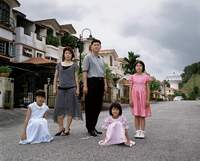 Third Sister's Fourth Son with Wife and three Daughters outside their suburban home, Kuala Lumpur